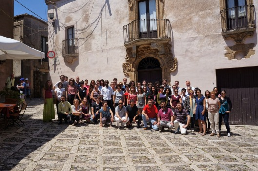 """The speakers and fellows of the 2014 edition of the Erie International School of Science journalism on """"The Digital World"""" posing in Piazza San Domenico in front of the Dirac Lecture Hall."""